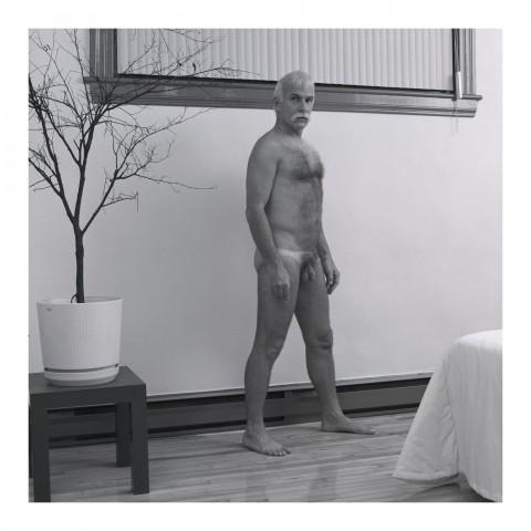 Homme dans sa chambre. Québec 1988