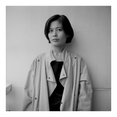 Mrs JungJin Lee, wearing a raincoat. NYC. 1989
